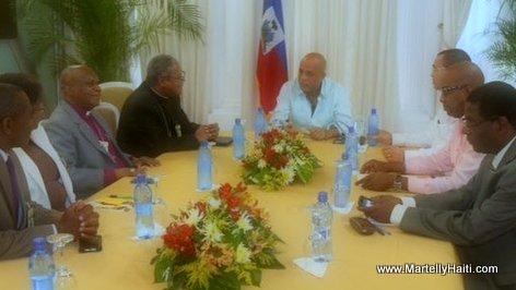 PHOTO: Haiti - President Martelly en conversation avec les membres de Religions pour la Paix