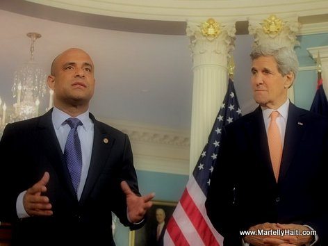 PHOTO: Haiti PM Laurent Lamothe and US Secretary of State John Kerry in Washington...