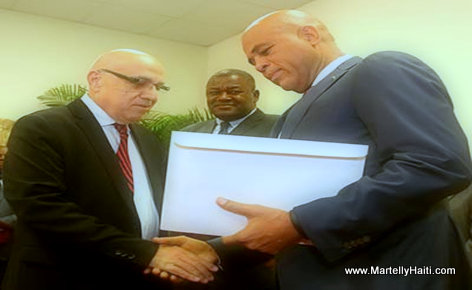 PHOTO: Haiti - Reginald Boulos presents Commission Report to President Michel Martelly