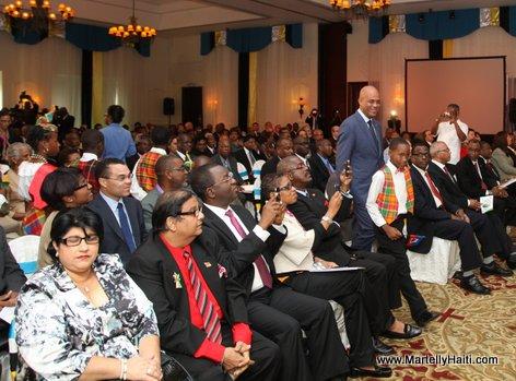 President Michel Martellyi se deplacant en direction du Podium ou se deroule la Conference