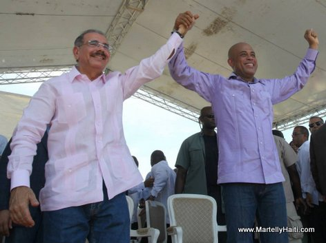 Presidents Michel Martelly and Danilo Medina Standing together...