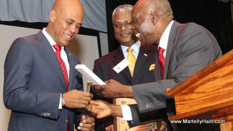 Haiti President Martelly accepting key to city of Spring Valley NY from Mayor Demeza Delhomme