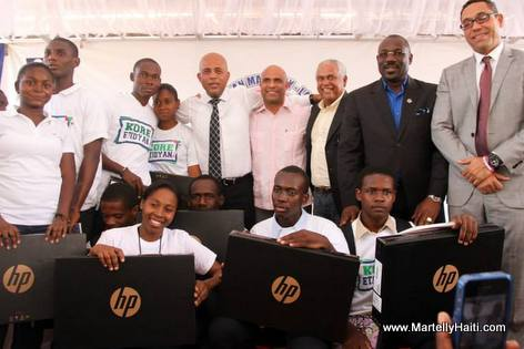 Haiti President Martelly Distributes 500 Laptops to Haitian Students
