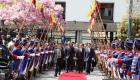 President Michel Martelly accompagne du Ministre des Relations exterieures, arrive sur la Place des Heros de l'independance Equatorienne