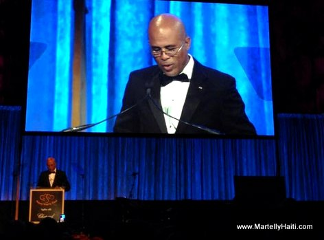 Haiti President Martelly giving a speech upon receiving the Happy Hearts Fund Leadership in Education award