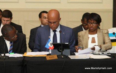President Michel Martelly et les membres de sa delegation en plein travail
