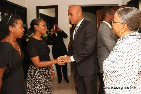 PHOTO: Haiti President Martelly visit Manigat Family after death of Lesly Manigat