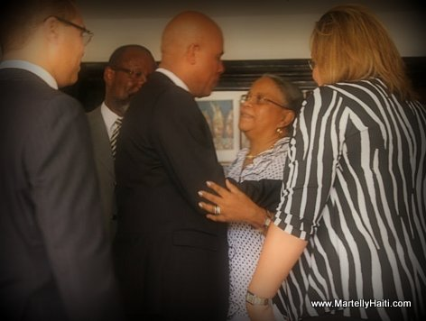 PHOTO: Haiti President Martelly visits Mirlande Manigat after death of husband Lesly Manigat