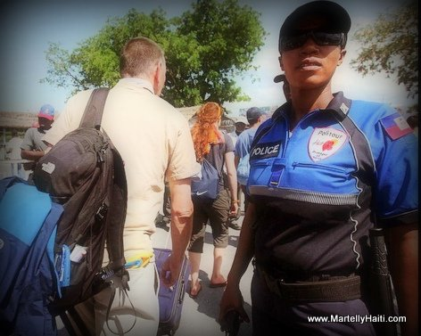 PHOTO: Haiti Airport - Tourism Police (POLITOUR) Providing Security to Airline Passengers